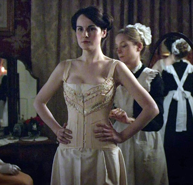 Anna dressing Lady Mary. Image from dailymail.co.uk